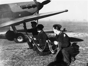 Vintage areoplane with men assisting