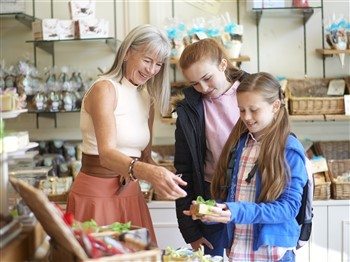 Lady and two girls in a chocolate shop