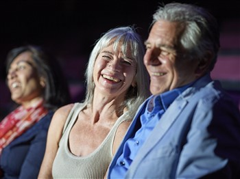 A couple enjoying a theatre show