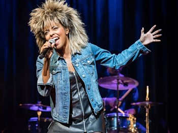 The charater, Tina Turner, on stage in the musical
