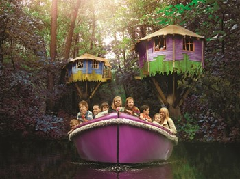 Family in a boat at BeWILDerwood