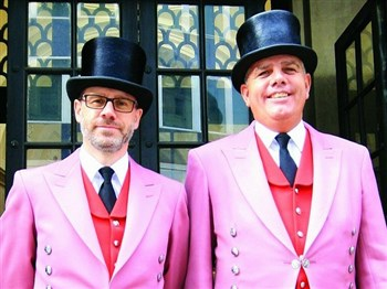 Two men in pink suits and top hats