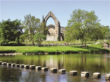 Bolton Abbey behind river in sunny weather