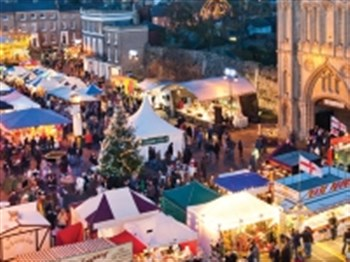 A range of christmas market stalls in Bury St Edmunds Angel Hill