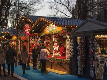 Christmas market stall selling teddys called Santa's Workshop