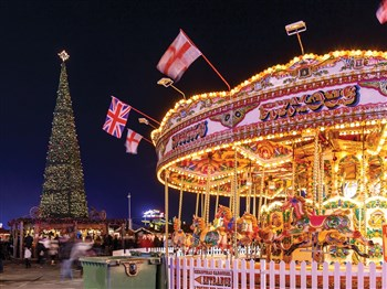 An illuminated carosel set in Hyde Park Winter Wonderland