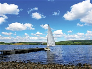 Sailing boat by jetty in Kielder Water