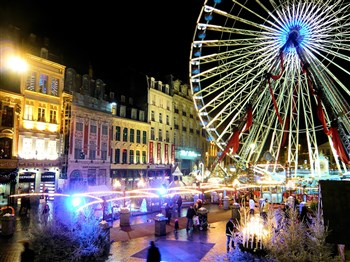 An illuminated evening view of Lille christmas market