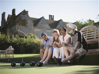 People playing boules at Warner's Littlecote House