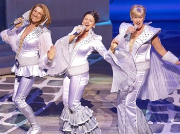 Three main charaters from Mamma Mia in full costume singing
