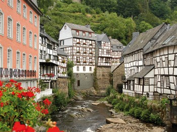 Old buildings by stream in Monschau