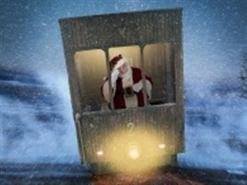 Father Christmas looking out of the back of a train