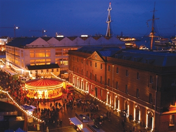 Portsmouth Victorian Festival of Christmas with he dockyard in the background