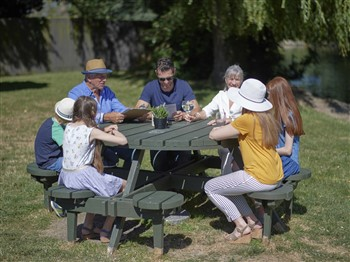 Family sitting at a picnic bench